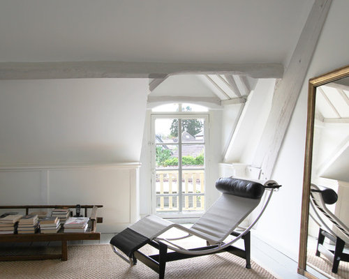 Inspiration For A Farmhouse Bedroom Remodel In Paris With White Walls