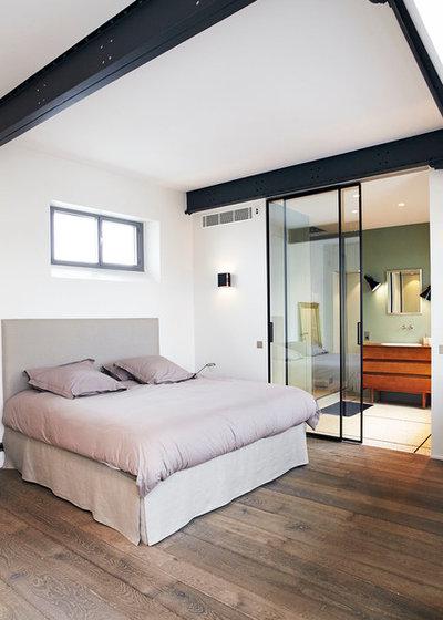 Industrial Dormitorio by LORRAINE COLSON   Architecte d'Intérieur