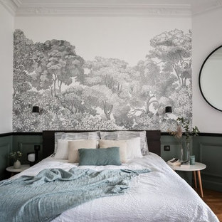 Photo of a large contemporary master bedroom in Paris with green walls, light hardwood floors and brown floor.