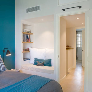 Design ideas for a mid-sized contemporary master bedroom in Marseille with multi-coloured walls, terra-cotta floors and beige floor.
