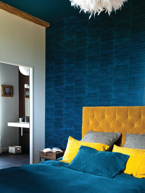 Example Of A Mid Sized Trendy Master Bedroom Design In Lyon With Blue Walls