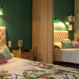 Mid-sized midcentury master bedroom in Marseille with green walls and terra-cotta floors.