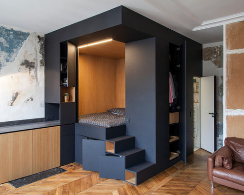 dark wood floor bedroom. example of a small trendy master dark wood floor bedroom design in paris with black walls t