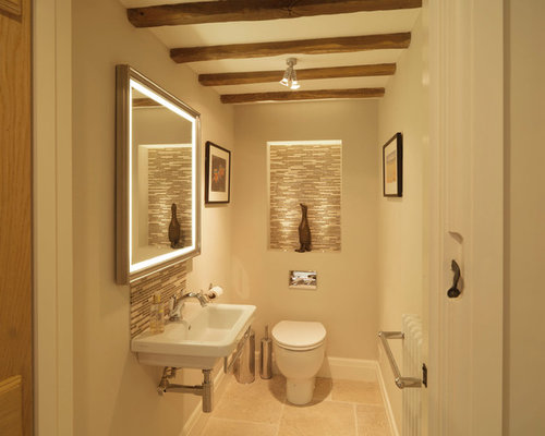 Photo Of A Small Rural Cloakroom In Hampshire With A Wall Mounted Sink,  Beige