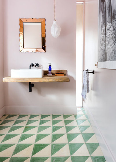 Eclectic Powder Room by Richard Parr + Associates