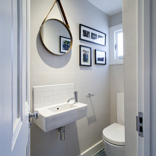 Design ideas for a small contemporary cloakroom in London with a one-piece toilet and ceramic flooring.