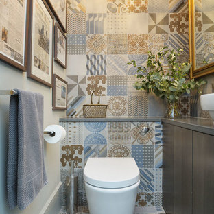 Design ideas for a contemporary cloakroom in London with flat-panel cabinets, dark wood cabinets, a one-piece toilet, grey walls and a vessel sink.