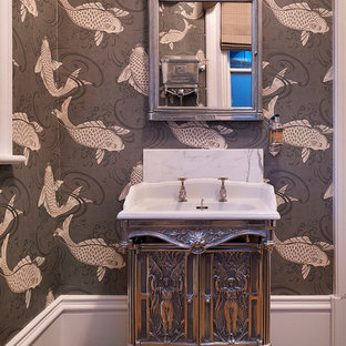 Powder room - small victorian medium tone wood floor powder room idea in Other with an integrated sink, furniture-like cabinets and multicolored walls