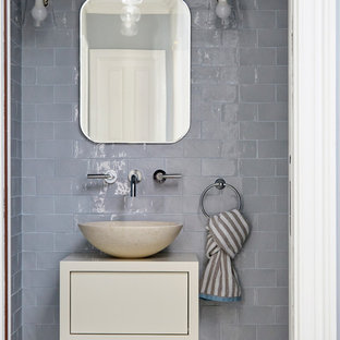 Classic cloakroom in London with flat-panel cabinets, beige cabinets, grey tiles, metro tiles, a vessel sink and multi-coloured floors.