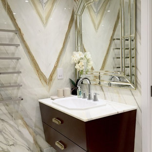 Contemporary cloakroom in London with a built-in sink, freestanding cabinets, dark wood cabinets, multi-coloured tiles and marble tiles.