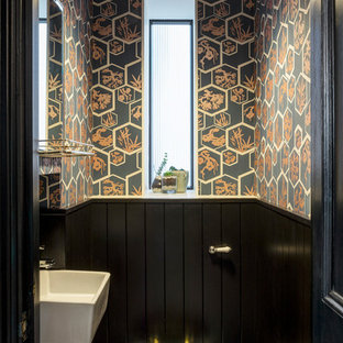 Design ideas for a traditional cloakroom in London with a wall mounted toilet, multi-coloured walls and a wall-mounted sink.
