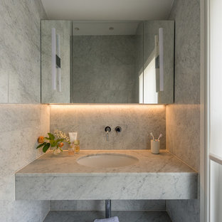 Design ideas for a contemporary cloakroom in London with grey tiles, a submerged sink, marble worktops and white worktops.