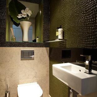 Réalisation d'un WC et toilettes design avec du carrelage en pierre calcaire.