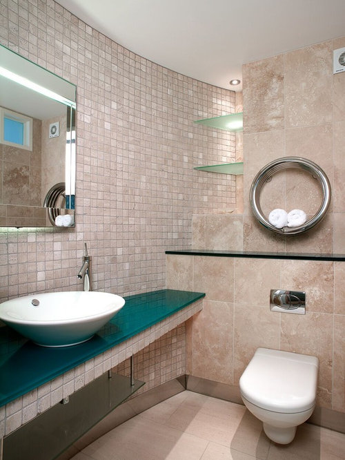 Small Modern Cloakroom In Dorset With Open Cabinets, A Wall Mounted Toilet,  Beige Tiles