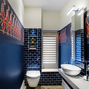 Inspiration for an eclectic cloakroom in Hampshire with blue tiles, blue walls, limestone flooring, brown floors, a wall mounted toilet, metro tiles, a vessel sink and grey worktops.