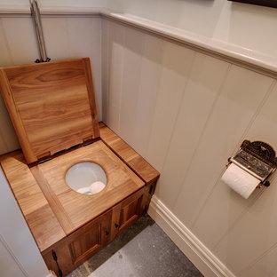 Ispirazione per un piccolo bagno di servizio country con ante a filo, ante grigie, WC sospeso, pareti grigie, pavimento in ardesia, lavabo a colonna e pavimento grigio