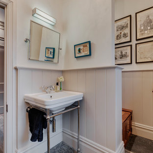 Inspiration for a small rural cloakroom in Devon with beaded cabinets, grey cabinets, a wall mounted toilet, grey walls, slate flooring, a pedestal sink and grey floors.