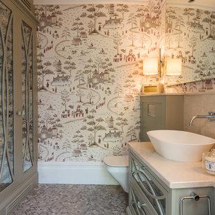На фото: класса люкс большие туалеты в классическом стиле с стеклянными фасадами, серыми фасадами, инсталляцией, бежевой плиткой, мраморной плиткой, разноцветными стенами, полом из мозаичной плитки, настольной раковиной, мраморной столешницей, серым полом и бежевой столешницей
