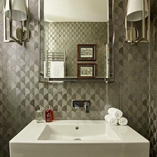 Пример оригинального дизайна: туалет в современном стиле с плоскими фасадами, серыми фасадами, инсталляцией, цементной плиткой, серыми стенами, полом из керамогранита, монолитной раковиной и серым полом