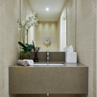 Inspiration for a small contemporary cloakroom in West Midlands with beige cabinets, beige tiles, porcelain tiles, beige walls, ceramic flooring, quartz worktops, beige floors, beige worktops, a floating vanity unit and a submerged sink.