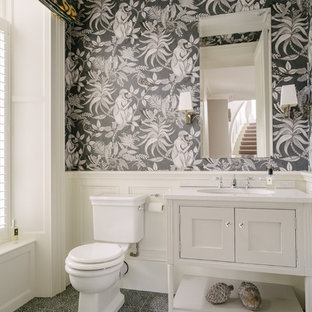 Design ideas for a small classic cloakroom in Belfast with white cabinets, porcelain flooring, blue floors, beaded cabinets, black walls, a submerged sink and white worktops.