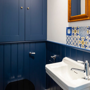 Inspiration for a victorian cloakroom in London with shaker cabinets.
