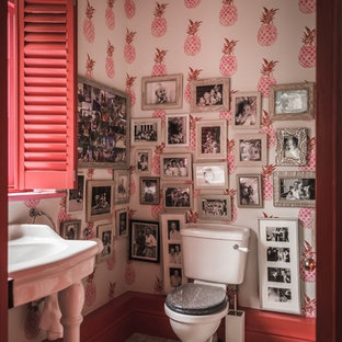 Design ideas for a small bohemian cloakroom in Hampshire with a two-piece toilet, a console sink, grey floors and multi-coloured walls.