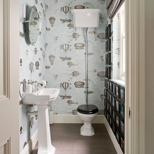 Inspiration for a medium sized traditional cloakroom in Wiltshire with a two-piece toilet, a pedestal sink, multi-coloured walls, medium hardwood flooring and brown floors.