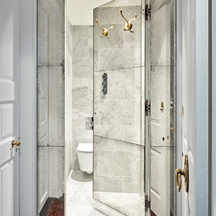 Photo of a small classic cloakroom in London with a one-piece toilet and white walls.