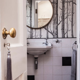 Inspiration for a small traditional cloakroom in Hampshire with black and white tiles, ceramic tiles and ceramic flooring.