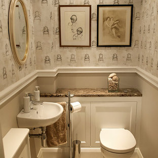 Elegant powder room photo in London with marble countertops