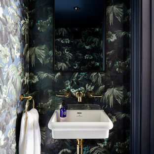 Photo of a small contemporary cloakroom in London with multi-coloured walls, wallpapered walls and a wall-mounted sink.