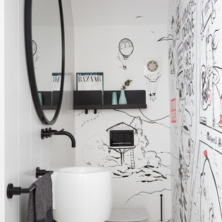 Medium sized contemporary cloakroom in London with a wall mounted toilet, white walls, marble flooring, a wall-mounted sink and grey floors.