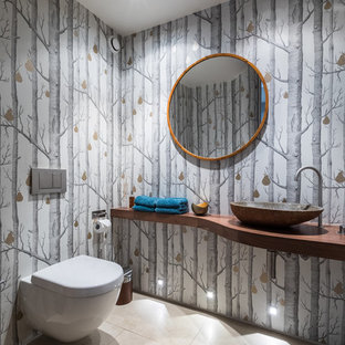 Inspiration for a contemporary cloakroom in London with multi-coloured walls, a vessel sink, wooden worktops, beige floors and brown worktops.
