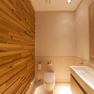 Esempio di un bagno di servizio design di medie dimensioni con lavabo rettangolare, pavimento con piastrelle in ceramica e WC sospeso