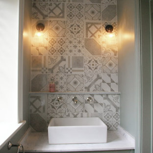 Design ideas for a small country cloakroom in Wiltshire with shaker cabinets, marble worktops, a two-piece toilet, multi-coloured tiles and a vessel sink.
