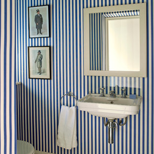 Powder room - victorian powder room idea in London with a wall-mount sink and blue walls