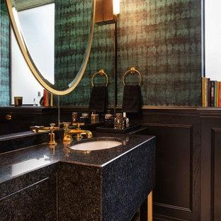 ロンドンのコンテンポラリースタイルのおしゃれなトイレ・洗面所 (フラットパネル扉のキャビネット、黒いキャビネット、テラゾーの床、御影石の洗面台、黒い洗面カウンター) の写真