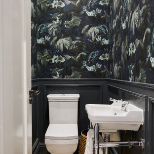 Inspiration for a medium sized classic cloakroom in London with a one-piece toilet, multi-coloured walls, light hardwood flooring, a console sink, beige floors and tongue and groove walls.