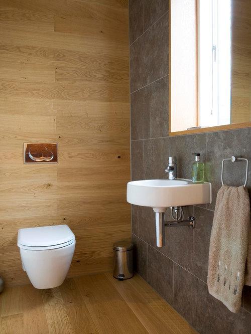 g stetoilette g ste wc mit hellem holzboden und braunen fliesen ideen f r g stebad und g ste. Black Bedroom Furniture Sets. Home Design Ideas