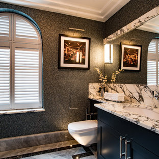 Design ideas for a classic cloakroom in Buckinghamshire with shaker cabinets, black cabinets, a wall mounted toilet, black walls, marble flooring, a submerged sink, grey floors and grey worktops.