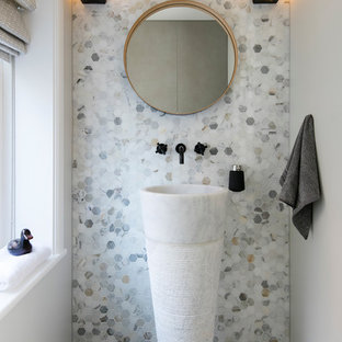 Contemporary cloakroom in London with grey walls, a pedestal sink and grey floors.