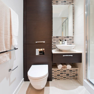 Contemporary cloakroom in London with a vessel sink, flat-panel cabinets, dark wood cabinets, beige tiles, matchstick tiles, white walls and a wall mounted toilet.