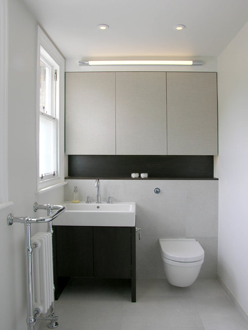 Example Of A Trendy Gray Tile Powder Room Design In London With An Integrated  Sink,