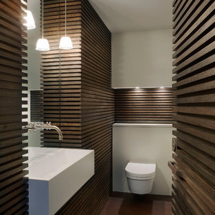Trendy powder room photo in London with a wall-mount sink and a wall-mount toilet