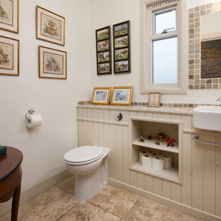 Medium sized rural cloakroom in Other with a one-piece toilet, white walls, beige floors, beige cabinets, ceramic flooring, tiled worktops and open cabinets.