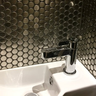 Design ideas for a small contemporary cloakroom in Surrey with grey tiles, mosaic tiles, grey walls, ceramic flooring and a wall-mounted sink.
