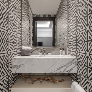 Design ideas for a contemporary cloakroom in London with multi-coloured walls, an integrated sink, marble worktops, grey floors and white worktops.