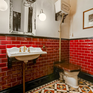 Photo of a medium sized classic cloakroom in London with a one-piece toilet, red tiles, metro tiles, grey walls, mosaic tile flooring, a console sink and multi-coloured floors.