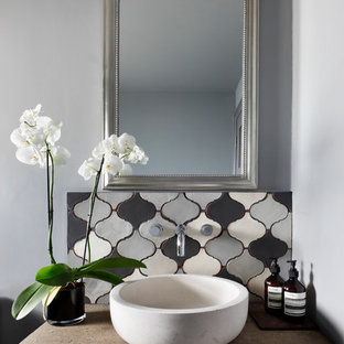 Design ideas for a small mediterranean cloakroom in London with ceramic tiles, grey walls, concrete worktops, freestanding cabinets, grey cabinets, grey tiles, a vessel sink and beige worktops.